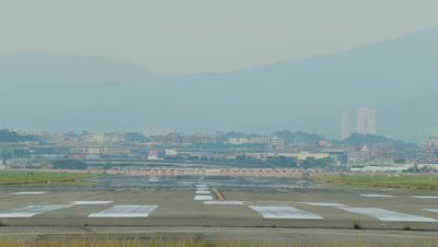Airplane Taxiing at Taipei Songshan Airport, Taipei, Taiwan