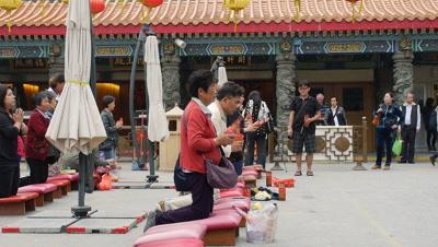 People Practicing Kau Cim (Chi Chi Stick) in Wong Tai Sin Temple, Hong Kong