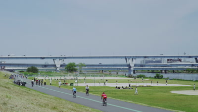 People enjoying sports along Arakawa River in Tokyo, Japan