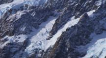 Shot Pans Up. Detail Of Glaciers, Southern Alps, Rocky Peaks, Snow And Ice, Mountain Tops. Aoraki, Mount Cook, New Zealand.