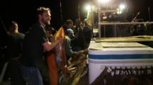 Humboldt Squid Fishing, Man Stuffs Huge Squid Into Sack, Sacks Full