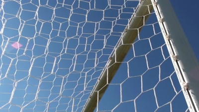 Soccer goal net and blue sky
