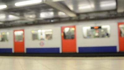 trains pass in London underground station