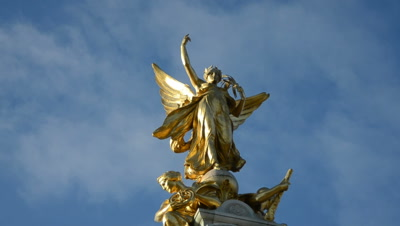 time lapse,clouds move behind winged victory sculpture on top of Victoria Memorial,London