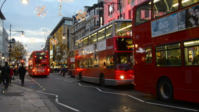 double-decker buses and pedestrians on london street