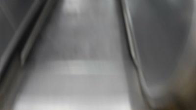 pov riding down escalator at London underground