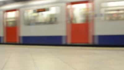 soft focus,train passes in London underground station
