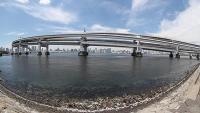 Ultra-wide,Fisheye view,Rainbow Bridge and Tokyo cityscape skyline across bay,from Daiba Park