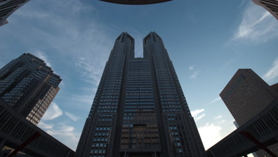 Fisheye,Time-lapse day to night pan up view of Tokyo Metropolitan Office Building in Shinjuku,Tokyo,Japan