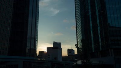 Time-lapse view betweenn buildings of Shiodome business district at dusk,Tokyo,Japan
