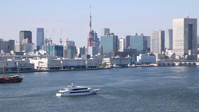 Boats cruising at Tokyo Bay and view of Tokyo cityscape from Rainbow Bridge, Tokyo, Japan