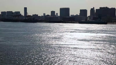 View of Tokyo Bay and silhouetted cityscape from Rainbow Bridge,Tokyo,Japan