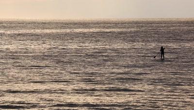 Paddle surfer at sunset in Enoshima, Kanagawa Prefecture, Japan