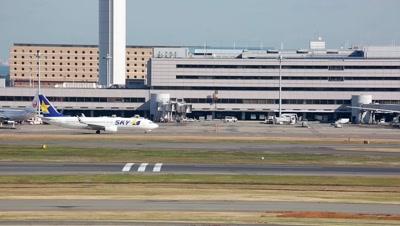 Airplane taxiing at Tokyo International Airport,Tokyo,Japan