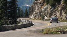 Cars Drive On Road Through Mt. Rainier National Park