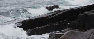 Granite cliffs meet the sea