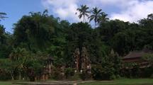 Tirta Empul Establishing Shot. Temple Amid Jungle
