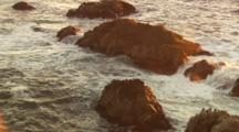 Crashing Surf On Golden Rocks Rainbow Spray