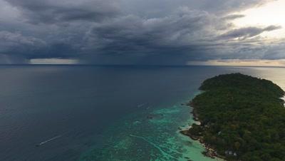 Flying over sea to thunderstorm on horizon, 4k