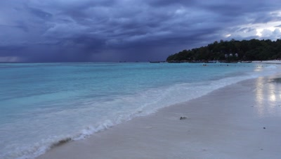 Landscape with a white sandy beach on the background of a stormy sky, Koh Lipe island, Thailand, 4k