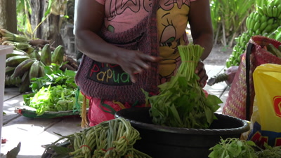 Papuan locals selling vegetables to resort