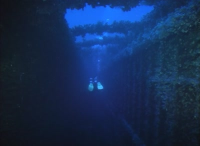 Technical Diver Swimming Inside The Promenade Deck Of The Hmhs Britannic Shipwreck
