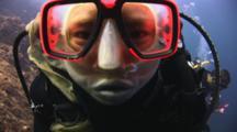 Female Scuba Diver Imitates Fish