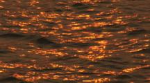 Sunset Reflected On Rippling Water