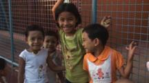Smiling Burmese Children With Thanakha Face Paint At Kaw Thaung In Myanmar