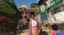 Burmese Woman Carries Tray On Head At Kaw Thaung In Myanmar