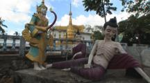 Symbolic Statues And Reclining Buddha Image At Buddhist Temple At Kaw Thaung, Myanmar
