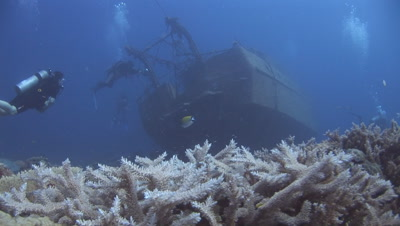 Scuba Divers Explore The Stern Of The Nasi Yalodina Shipwreck