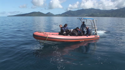 Rigid Inflatable Boat Transports Scuba Divers To Nigali Passage. Gau Island In Background