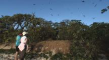 Birdwatchers Observe Birds Flying Over Trees At Vatu-I-Ra Island Bird Sanctuary, Fiji