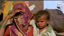 Indian Mother And Child, Mother's Face Obscured By Sari