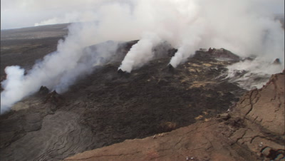 Aerial Tra Ms X 2 Lava Field, Multiple Vents Spewing Gases, Z./I Large Vent Molten Lava Visible Z/O