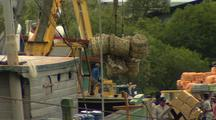 Bales Hoisted By Crane Onto Boat, Busy Old Style Port.