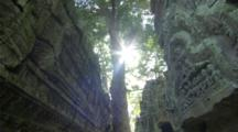 Dolly Glide Shot Of Angkor Ruins With Sunlight And Skull Sculpture