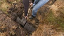 Man Cuts,shovels Peat Into Blocks At Volunteer Point