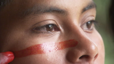 Indigenous People In Amazon Forest,Bullet Ant Ritual,Woman Applies Body Paint To Young Man