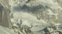 Close Up Time Lapse Shadows Of Clouds Above Snow-Covered Mountains