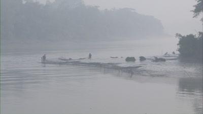 Travel Past Fishermen Adjusting Fishing Nets In River