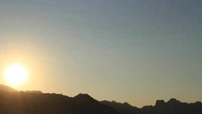 Time lapse of sunrise over mountains at Komodo National Park