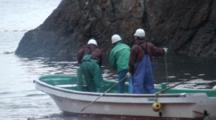 Fishermen On Boat Stabbing Dolphins With Spears