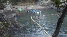 Captured Pilot Whale Is Loaded On Stretcher Tied To Boat
