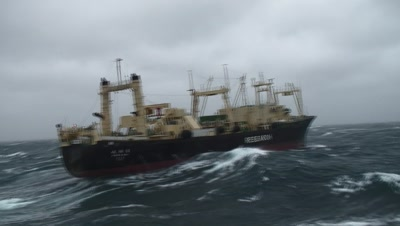 Japanese Whaling Ship Nisshin Maru Escaping From Sea Shepherd In Stormy Seas