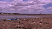 Low Water Level In Water Supply Dam Affected By Drought Near Brisbane, Trash In Foreground