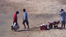 Fishermen Unload Stingrays From Skiff For Market, Puerto Angel