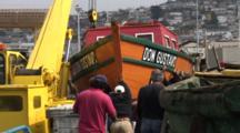 Fishermen Prepare To Hoist Wooden Fishing Boat For Launching--Chile