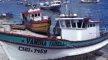 Working On Fishing Boats Aground At Low Tide